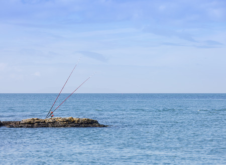 Sea fishing rods on a rockky outcrop