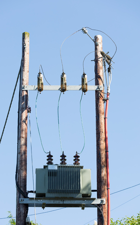 telephone poles: Power transformer and lines with blue sky