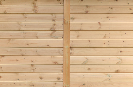 Wooden boards on the side of a timber structure Foto de archivo