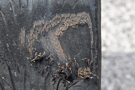 Car tyre worn through to steel belts