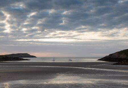 Cemaes Bay beach in Anglesey North Wales at low tide at dusk