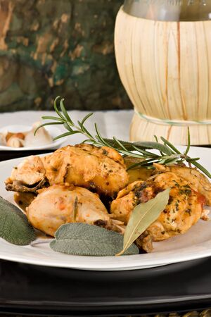 Chicken, stewed in tomato, wine and herb sauce