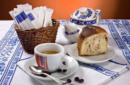 espesso: A cup of espesso coffee and a piece of cake for a perfect breakfast