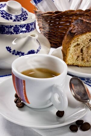 A cup of espresso coffee and a piece of cake for a perfect italian breakfast Stock Photo - 12003735