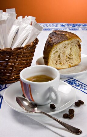 A cup of espresso coffee and a piece of cake for the morning  breakfast
