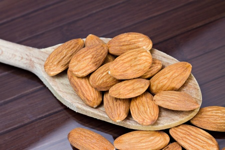 nut shell: Almonds Stock Photo
