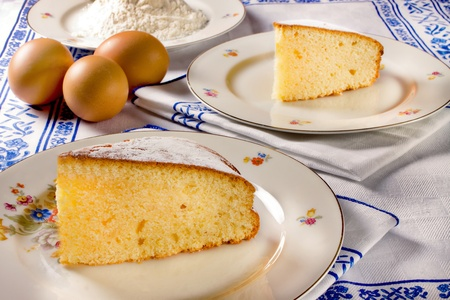 Slice of lemon cake and some ingredients
