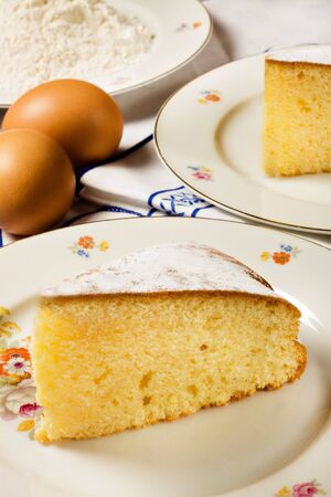 A slice of homemade lemon cake and ingredients Stock Photo