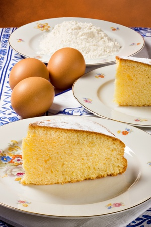 Slices of lemon cake, eggs and flour.... Stock Photo