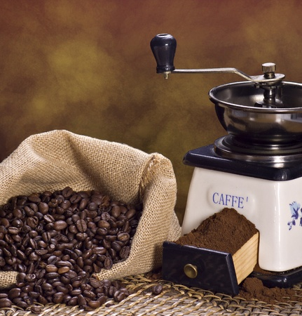 Coffee grinder and roasted coffee beans  Stock Photo - 12314467