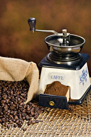 Coffee grinder and roasted coffee beans Stock Photo - 12314470
