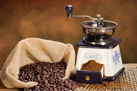 Coffee grinder and roasted coffee beans Stock Photo - 12314473