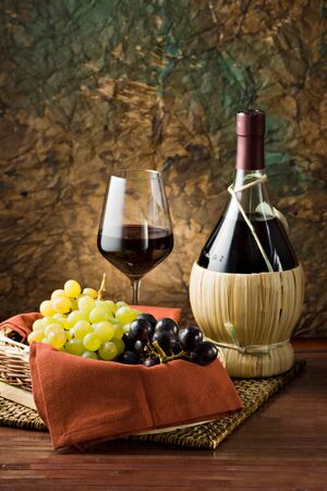 Grapes, bottle and a glass of wine Stock Photo - 13027501