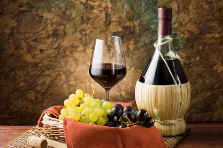 Grapes, bottle and a glass of wine photo