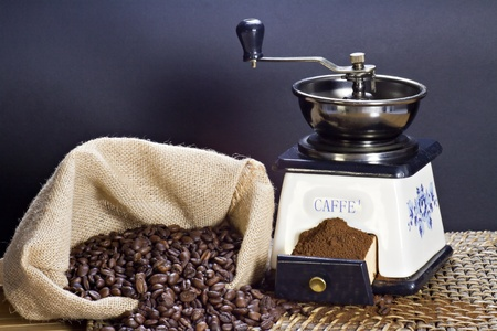 Coffee grinder and roasted coffee beans photo