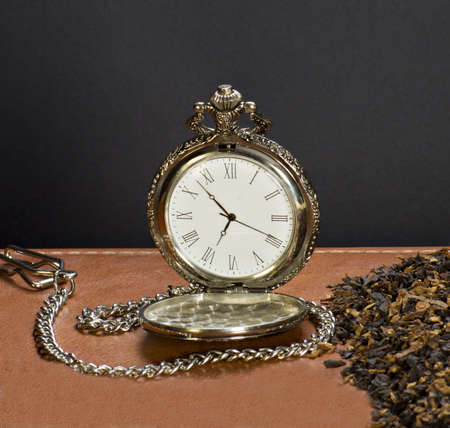 old watch: Old watch and  tobacco