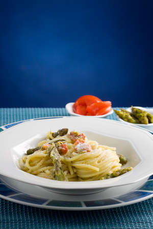 Italian pasta with tomatoes and asparagus  Stock Photo