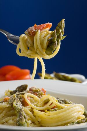 Italian pasta with tomatoes and asparagus  Stock Photo - 13956015
