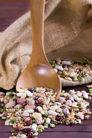 Mix of legumes in a wooden spoon photo