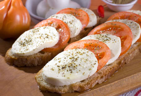 The  Caprese , mozzarella cheese and tomatoes - Italian recipe Stock Photo
