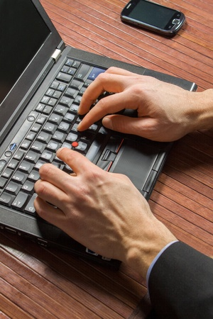 Businessman typing on a Personal Computer keyboard photo