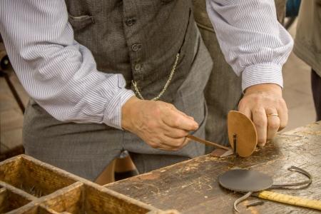 Der Schuh-Hersteller Standard-Bild