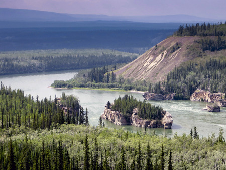 Landscape of the Yukon river in Canada Stock Photo