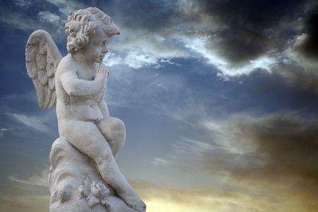 Thinking winged boy statue Stock Photo