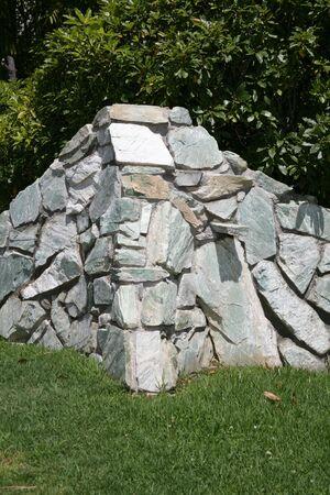 Rock retaining wall Stock Photo