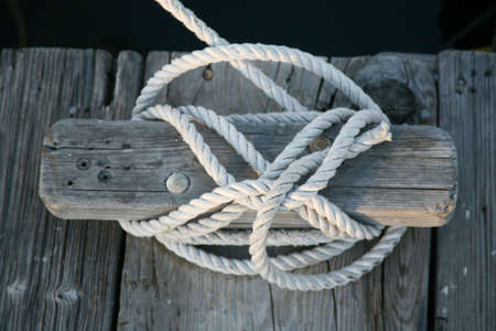cleat: Cleat with rope tied to it Stock Photo