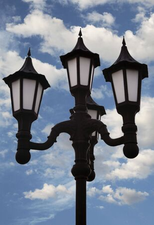 Cloudy sky with street lamp post photo