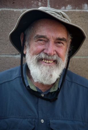 Elderly man wearing a hat photo