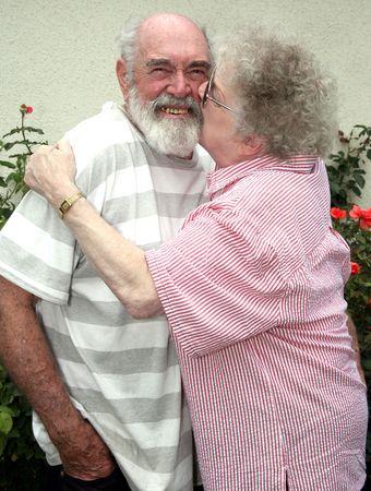 Grandmother kissing her husband Stock Photo - 437866