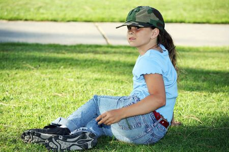 Young girl relaxing on the grass Stock Photo - 453046