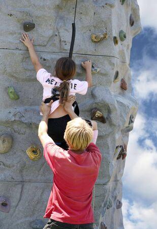 tenacity: Young lady rock climbing