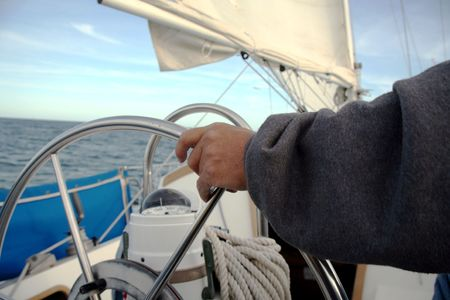 driven: Sailboat steering wheel being driven