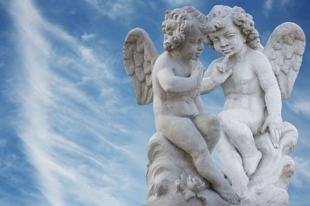 Two angels copying each other photo
