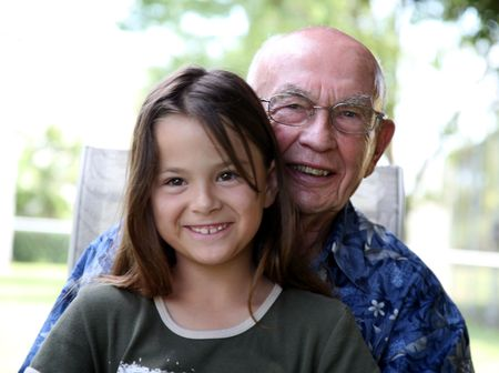 Grandfather with his granddaughter photo