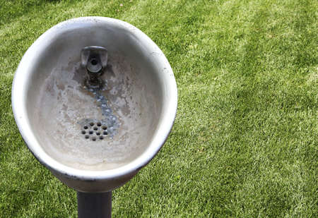 corroded: Corroded and weathered drinking fountain