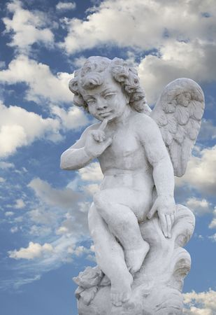 Beautiful angel statue with gorgeous sky photo