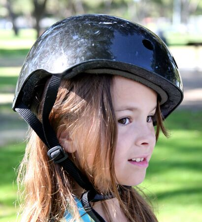 Girl wearing a helmet Stock Photo - 565680