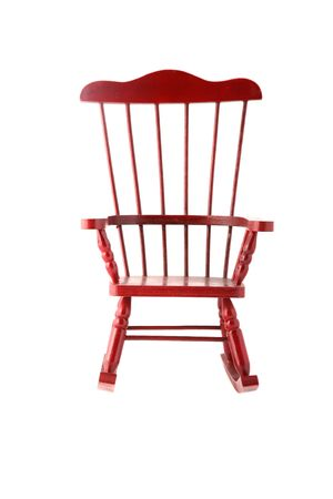 Beautiful red rocking chair made out of cherry wood photo