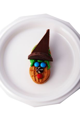 witch face: Peanut butter cookie decorated to look like a Halloween witch face Stock Photo