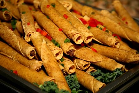 finger food: Delicious Mexican food called taquitos Stock Photo