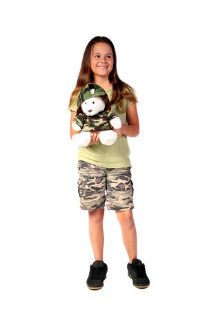Young girl dressed in army camouflage with her cute Christmas teddy bear photo