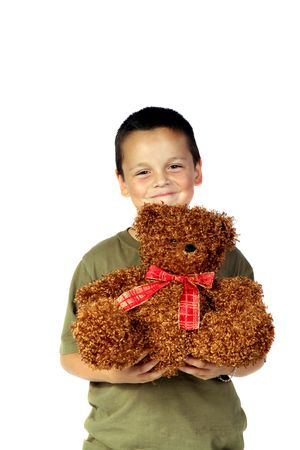 Young boy holding his Christmas teddy bear photo