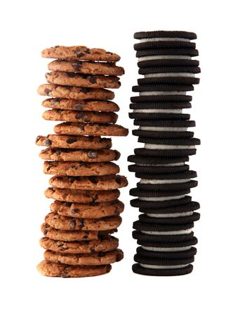 Stack of chocolate chip cookies and cream-filled sandwich cookies photo