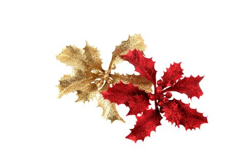 Shiny red and golden Christmas holly decorations photo