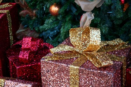Colorfully wrapped presents under a gorgeous Christmas tree