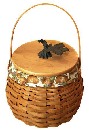 adorning: Delightful wicker basket with pumpkin fabric adorning it